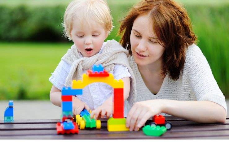 Mother and child with building blocks
